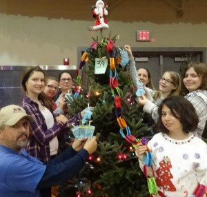 Decorating tree at Hometown Christmas for needy family.